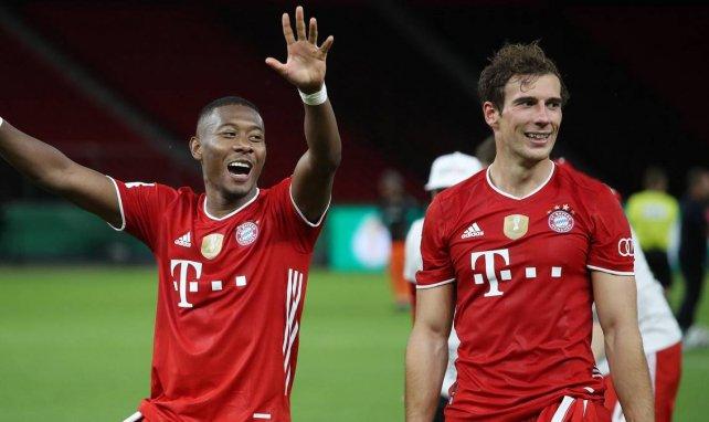 David Alaba (l.) und Leon Goretzka gewannen zusammen das Triple mit dem FC Bayern
