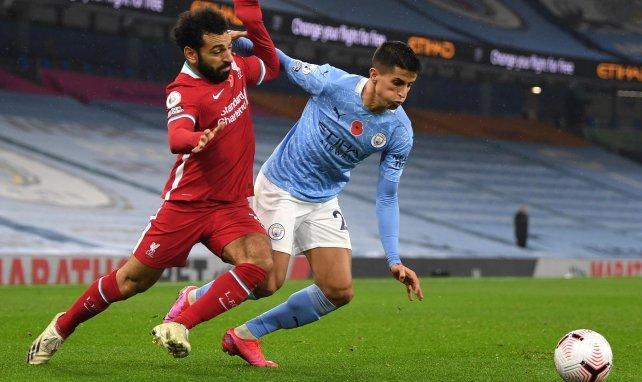 Mohamed Salah im Zweikampf mit Manchester Citys João Cancelo